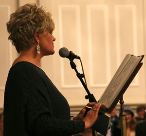 Claire Dyer speaking at a reading