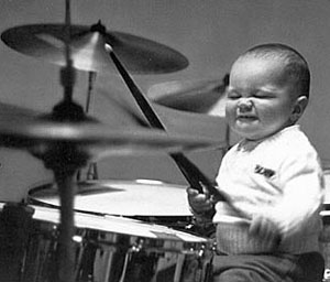 Child playing the drums